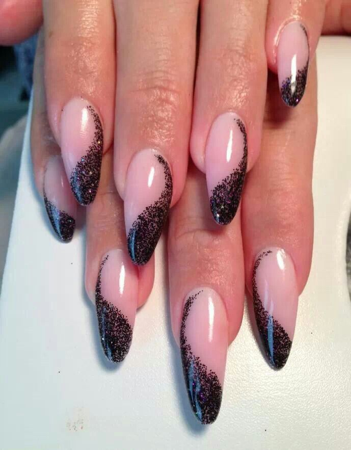 Great nail art. But I'm not a fan of the almond shaped nails. How about you?