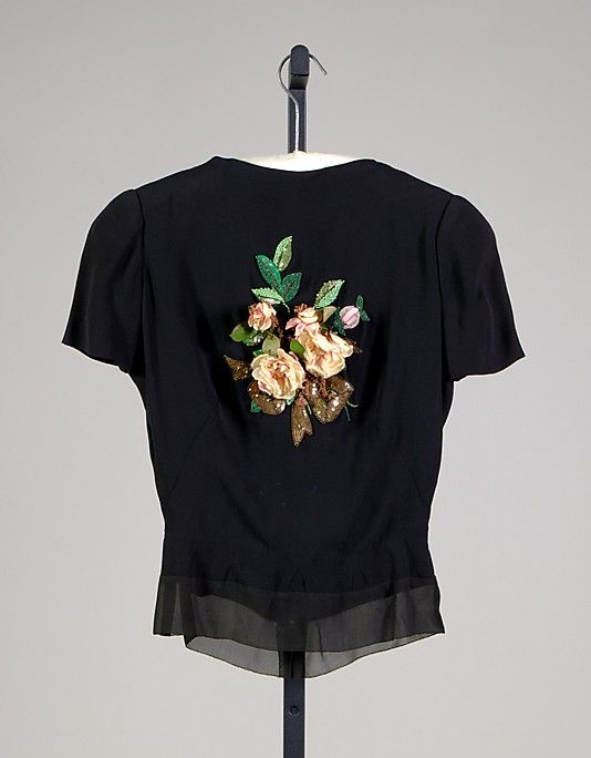 Evening blouse  House of Schiaparelli (French, 1928–1954)  Designer: Elsa Schiaparelli (Italian, 1890–1973) Date: ca. 1938 Culture: French Medium: Silk, beads, sequins, artificial flowers Credit Line: Brooklyn Museum Costume Collection at The Metropolitan Museum of Art, Gift of the Brooklyn Museum, 2012; Gift of Arturo and Paul Peralta-Ramos, 1954