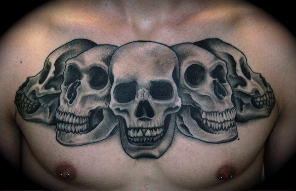 Skulls Chest Piece Tattoo by Phil Colvin #tattoo #tattoos #Ink #skulls http://tattoopics.org/skulls-chest-piece-tattoo-by-phil-colvin/