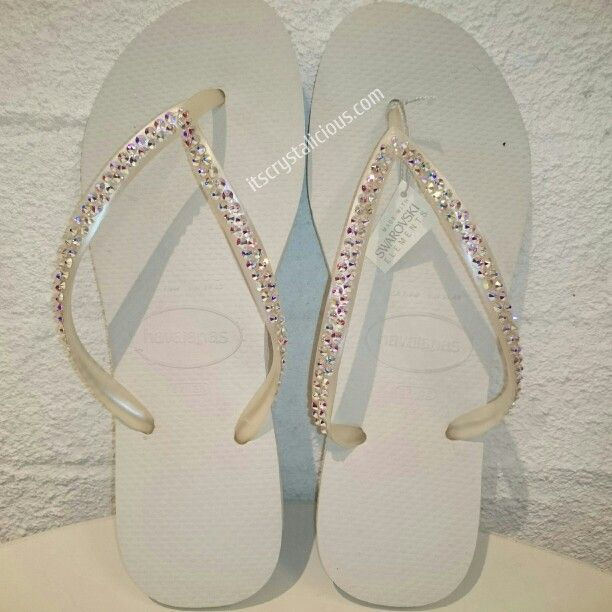 White Havaianas embellished with Genuine Crystal AB from @swarovski® are perfect for any Bride or Bridesmaids  Available in all crystal colors and Havaiana colors via www.itscrystalicious.com    #Bridesmaids #bride #beachwedding #beach #crystals #design #designer #crystalab #flipflops #havaianas #handmade  #swarovski #styleblogger #wedding #weddingday #summer #white #itscrystalicious