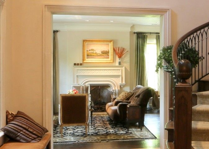 Sitting Area With Fireplace Off The Foyer Of A Southern English Manor House  In Dallas,