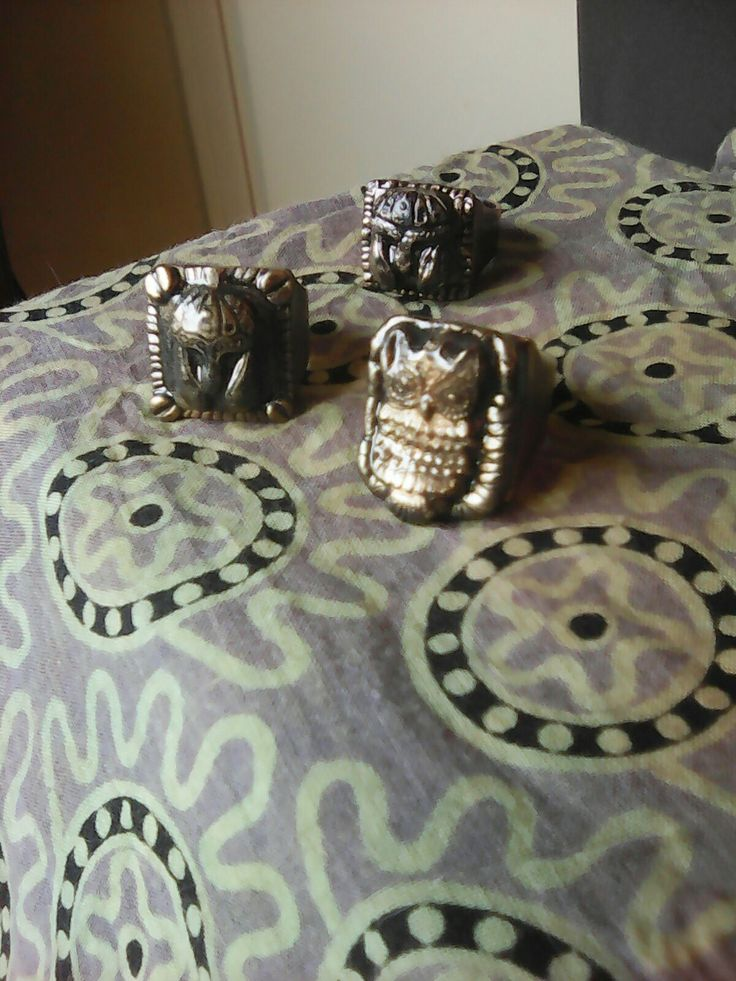 Helmet rings and an owl ring