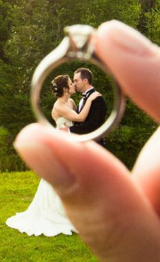 Photo idea--through the ring, kissing. With background in black and white.| g by Kandid Weddings Photography: