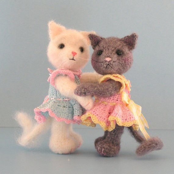 I like to look for Dolls with Cats..  this is more Doll who IS a cat.  Sadly, I will never crochet..  but the link is preserved in case someone who sees this might be interested.  Cat Doll With Dress PDF Crochet Pattern Book by BluebearyTreasures, $7.50