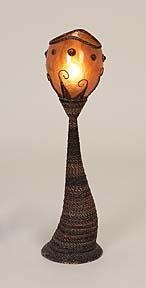 """Lamp 24"""" inches tall and 6 inches wide.  Designer lamp made from woven abanca wood with metal and glass shade.  www.theectecticyellowrose,com"""