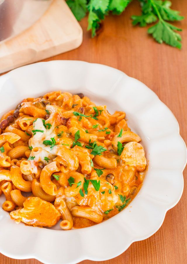 30 Minute Skillet Chicken Enchilada Pasta that is easy to make and very delicious. It's made with chicken and enchilada sauce and takes less than 30 minutes