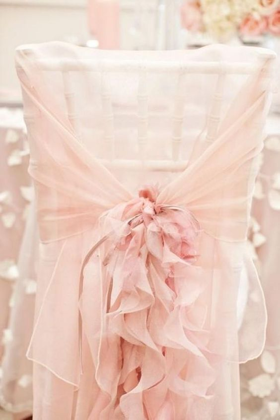 Blush chair covers for a romantic blush wedding.