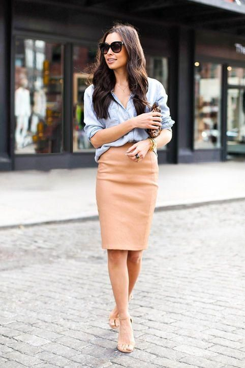 A camel pencil skirt and light blue denim/chambray shirt, tucked in - loving this look for work. Click for all 13 ways we're loving the pencil skirt for fall
