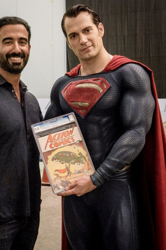Henry Cavill with Ayman Hariri and first Superman comic.