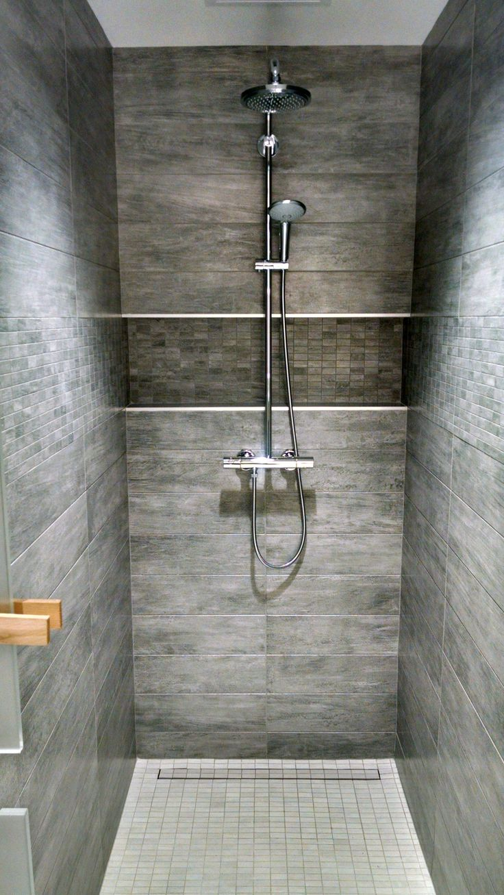Locker room Shower. Grohe valve with tile covered linear drain. No threshold.