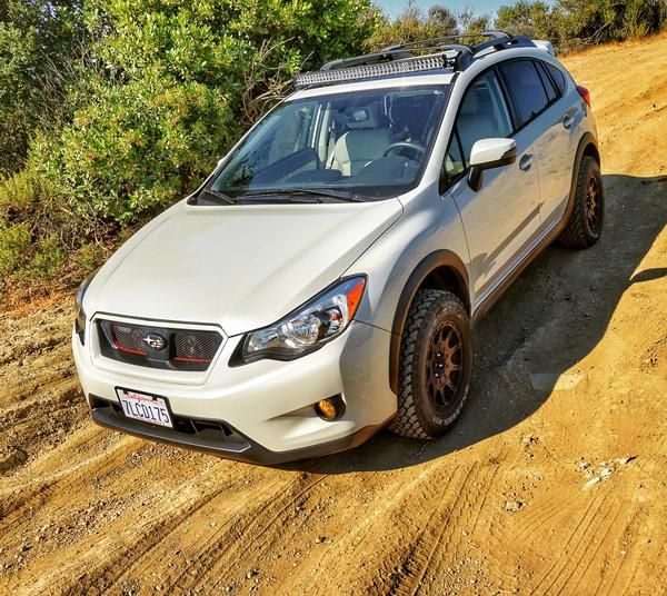 "Brand: Subaru Model: CrosstrekYear: 2015Color: Satin White Pearl     Modifications:  Lift kit: 1.5"" LP Aventure lift kitTires: General Grabber AT2 225/70/15 Wheels: Method Racing Wheels MR502 VT-Spec 15x7 +15Bike rack: Yakima Hold Up 2 LED bar: Auxbeam curved 42"" LED light bar 24000 lumens"