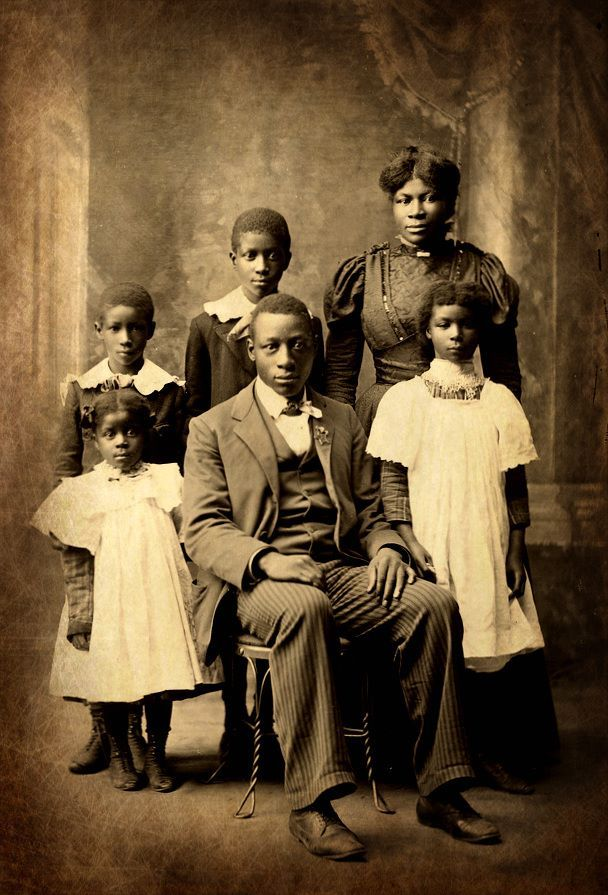 Portrait of a beautiful African American family identified as the Higdons. Photographed circa 1898 in Junction City, Kansas.