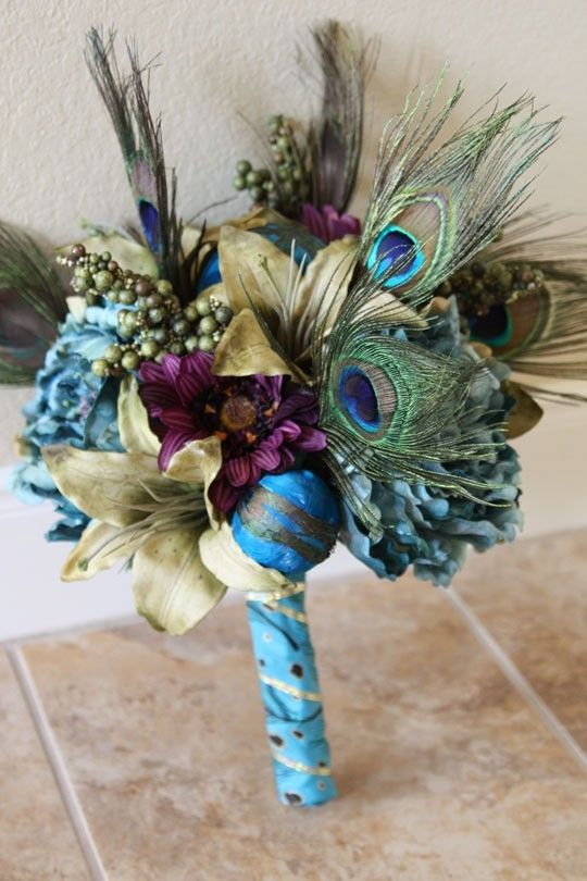 beautiful...you can put peacock feathers in the bouquets...oh i love this!