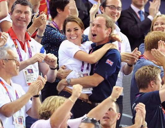 Catherine, Duchess of Cambridge and Prince William, Duke of Cambridge embrace after Philip Hindes, Jason Kenny and Sir Chris Hoy of Great Britain win the gold and a new world record in the Men's Team Sprint Track Cycling final during Day 6 of the London 2012 Olympic Games at Velodrome, Aug. 2, 2012 in London. (Pascal Le Segretain/Getty Images)