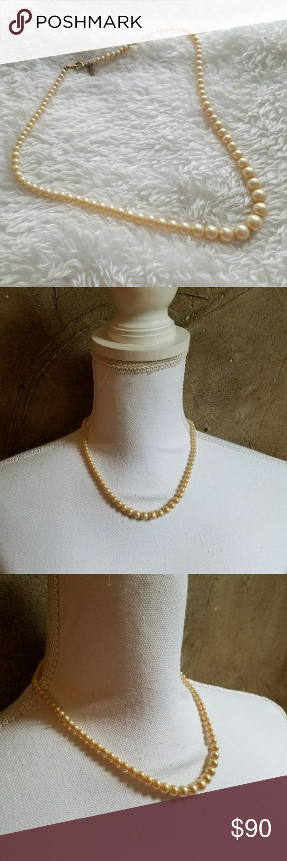 """Marvella 1940s Vintage Cream Pearl Necklace Graduated faux graduated pearl necklace. May be as old as 1940s. The quality of the the glass pearls is evident through the lack of wear and weight of pearls. Pretty pearl necklace perfect for any occasion. I bought this from an estate sale. Hang tag stamped Marvella. Excellent Vintage Condition. Minor signs of wear and needs come cleaning. Perfect for a bride or wedding. Offers welcome. Length 18"""". formal fancy pretty preppy elegant classic preppy…"""
