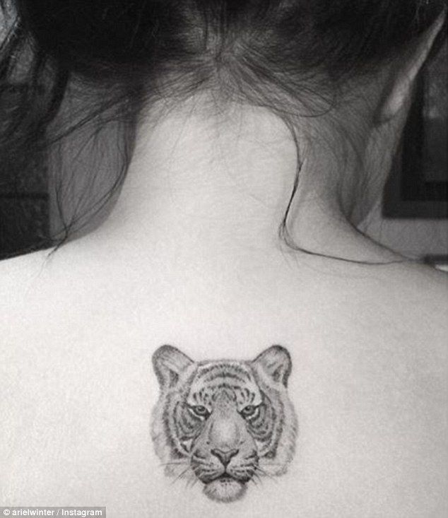 The ink: She recently revealed a tiger just below the back of her neck, and said she has five tattoos in all