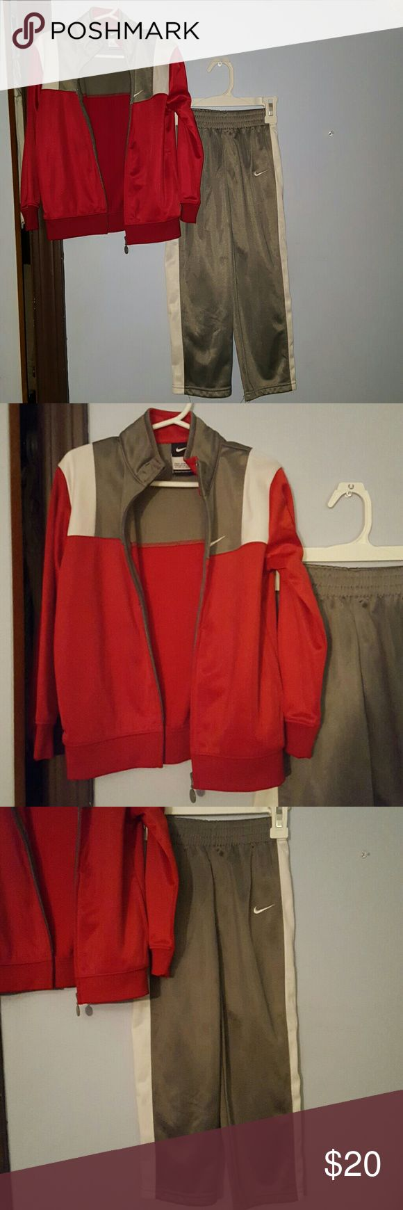 Kids Collection Nike sweat suits, red gray and white. Front zipper closure on the jacket and elastic waist on the pants. Nike Matching Sets