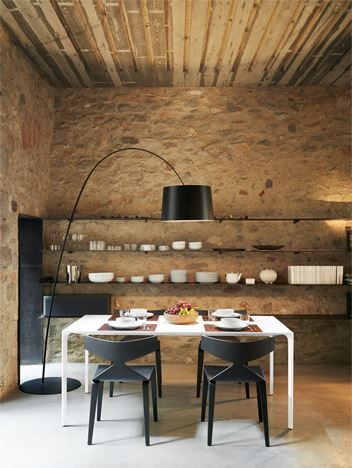 rustic modern dining room with saya chairs and nuur table from with a twiggy light from