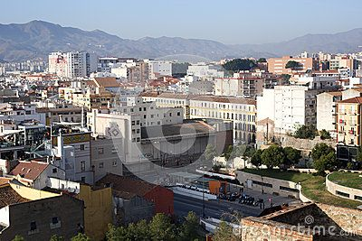 Malaga city view from Alcazaba fortification. Mountains on the background