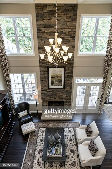 Family Room Design Ideas That Will Keep Everyone Happy: Fllor To Ceiling Stone Fireplace, Lots Of Natural Light