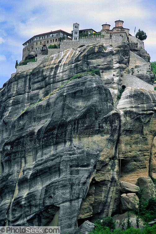 """Grand Meteora Monastery (Holy Monastery of Great Meteoron) was built in the mid 1300s on a rock pinnacle in Greece, Europe. It was restored and embellished in 1483 and 1552, and is the largest monastery at Meteora. Meteora (which means """"suspended in the air"""") is a complex of six Eastern Orthodox Christian monasteries built by medieval monks on natural rock pillars near Kalambaka, in central Greece, Europe.   <3"""