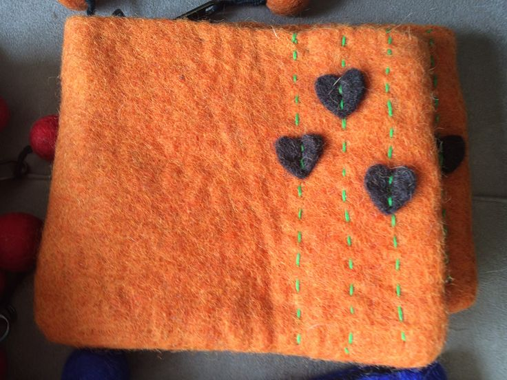 Maya - Felt Motif Purse (Medium). Felting is a specialty of the Nepalese artisans we have partnered with. Great little purse to put the little things that go missing in your handbag or to put your valuables when you don't want to take a handbag out.