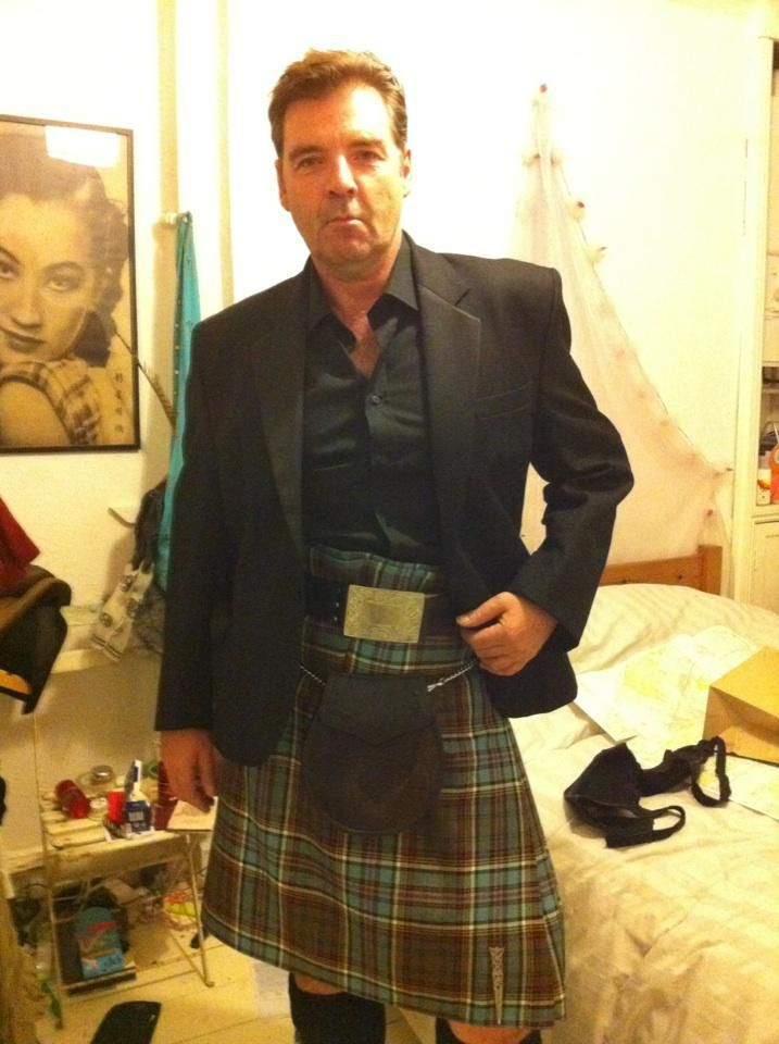 Bates in a Kilt!  I'm going to go ahead and assume that this actor lives with a woman, and that the black bra on the bed belongs to her.  He looks way hot in his kilt, and with no cane.
