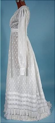 c. 1820's Dress of White Embroidered Muslin!  Delightful and feminine hand-stitched muslin dress embroidered all over with a small leaf design.  Slightly elevated waist.  The bodice and skirt are gathered into the waistband, and the lower skirt has a froth of pretty frills in fine muslin.http://antiquedress.com/item6717.htm
