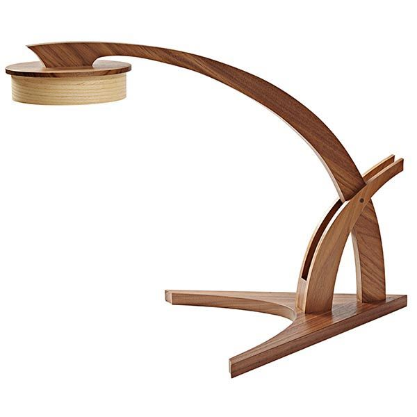 """Evoking the flora of the wide American grasslands, this modern desk lamp can freely range wherever a reading light is needed thanks to its uncorded, battery-powered LED light. Dimensions: 13-1/4""""W x 22""""D x 16-1/2""""H  Featured in WOOD Issue 234, September 2015"""