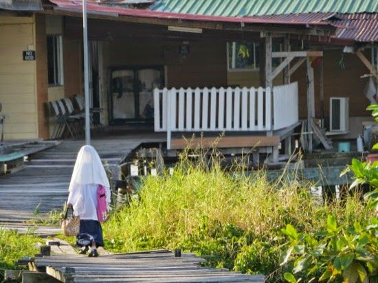 A child coming home from school - 'Venice of the East' - Bandar Seri Begawan, Brunei - been a long day