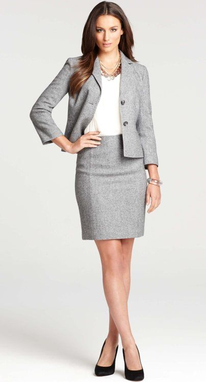 Ann Taylor professional skirt suit, but the skirt should go down to the knee. This ensures that is still a respectable length when you sit down.