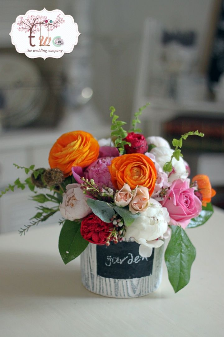Colored ranunculus arrangement