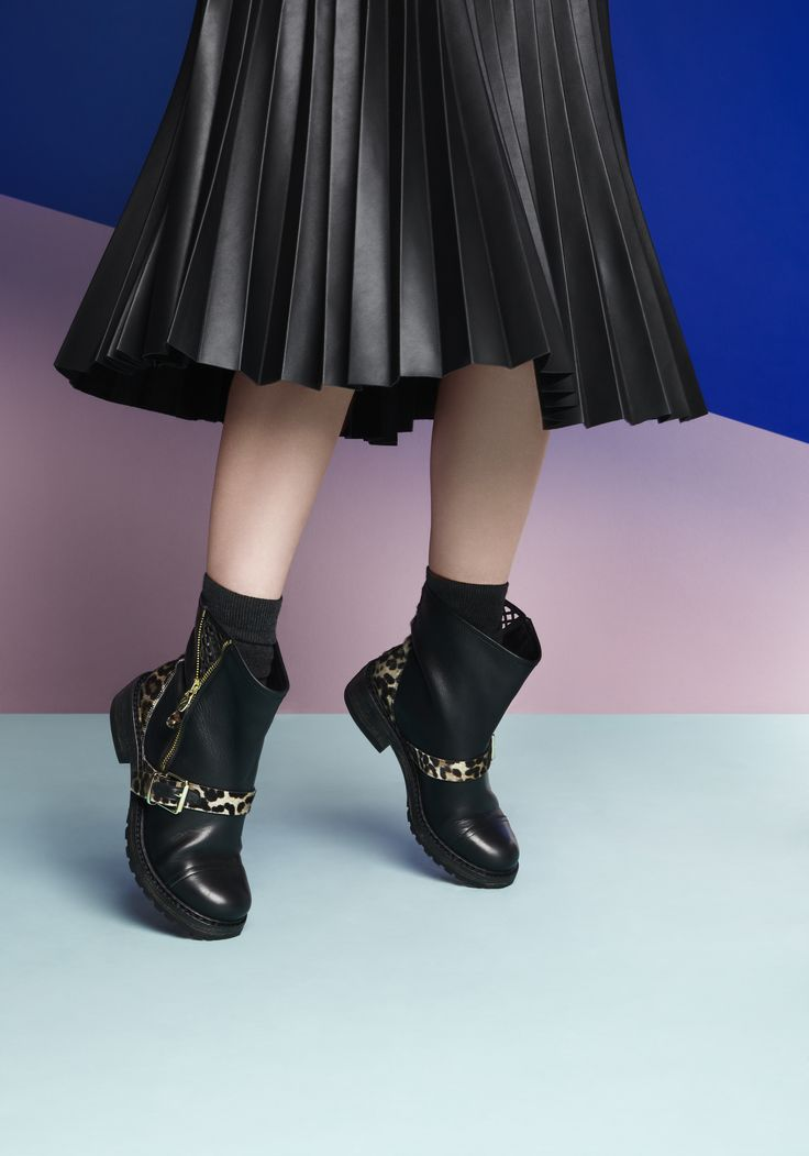 Ankle boots, black socks and leather skirt.