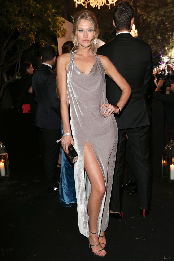 17 May 2016 - Toni Garrn showed off her figure in a velvet grey dress with a thigh-high slit.   - HarpersBAZAAR.co.uk
