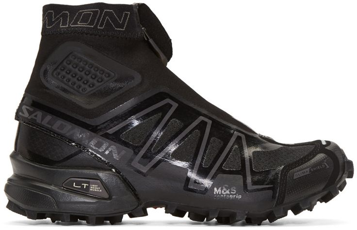 High-top Gore−Tex® and rubber trail running sneakers in black. Panelling throughout. Water resistant. Protective synthetic toe cap at round toe. Inset zippered gaiter panel featuring elasticized lycra collar. Quicklace lace-up closure. Logo patch at padded tongue. Padded collar. Logo accents at toe, sides, and heel. Textile, abrasion resistant lining  OrthoLite® sock liner and insole. Molded EVA midsole. Treaded rubber sole. Tonal stitching.
