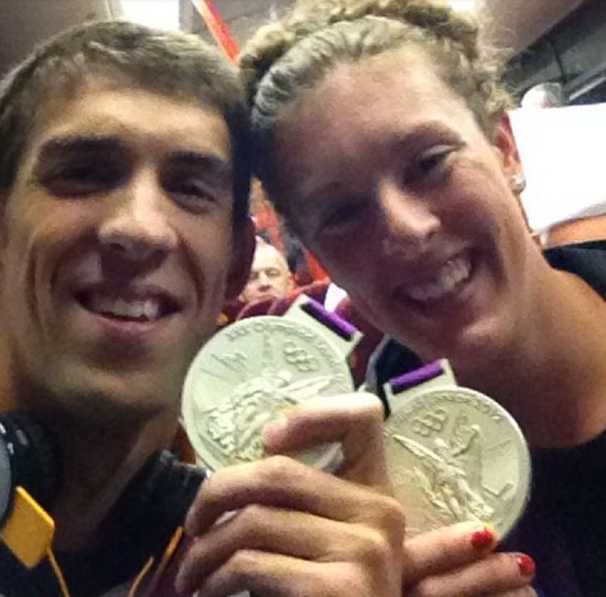 Michael Phelps and Allison Schmitt show off their Olympics medals!