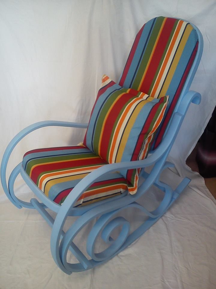 Upholstered and painted bent wood rocking chair.