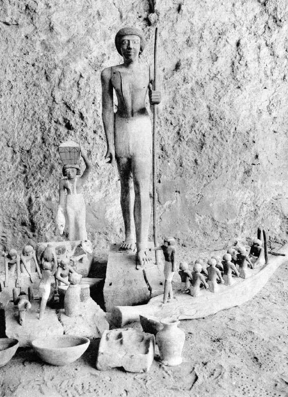 tanding figure of Wepwawetemhat, Asyut, 1st Intermediate Period, 10th or 11th Dynasty, painted wood, 112 × 23.1 cm, diam. 71.1 cm. MFA 04.1780. Excavation photograph, as discovered in 1903 by Chassinat and Palanque in an unplundered rock-cut tomb, Emily Esther Sears Fund, 1904. Courtesy of Une campagne du fouilles dans la nécropole d'Assiout, by É Chassiant et Ch. Palanque, 1911, Cairo