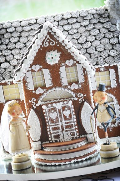 A gingerbread house wedding cake - what fun for a winter wedding.
