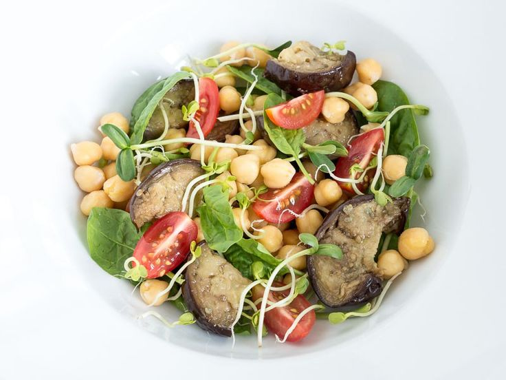 Here's another salad that I often make. I usually have some pre-cooked legumes and vegetables in the fridge so I can just mix something together real quick. A good protein source like chickpeas and some hearty eggplants soaked in oil's is a good place to start. Add some salad leaves of any sort and some