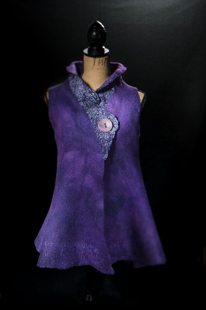 Another sleeveless vest with a velvet collar.