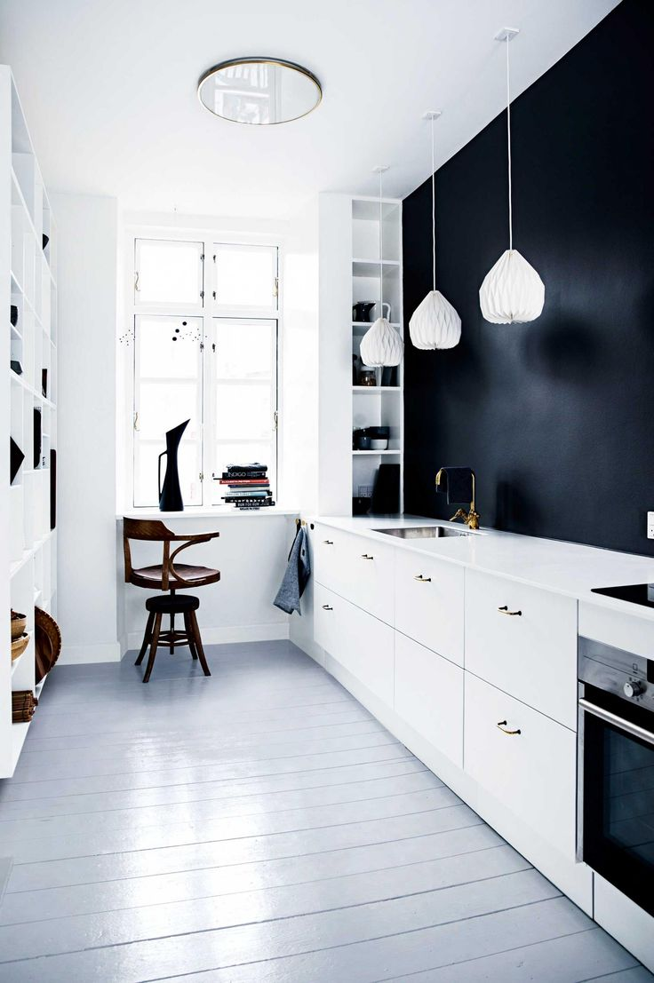 white kitchen with black wall and big open shelf