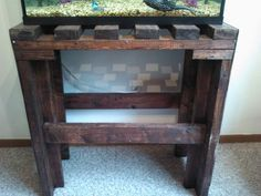 "This instructable will show you how to build your own SOLID HEAVY DUTY Fish Tank Stand! this holds well over 450lbs! This fish tank incorporates a ""rustic wood pallet"" look for cosmetic appeal and cool lighting effects below the fish tank!"