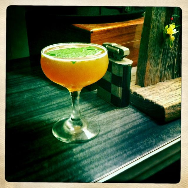 The Expatriate:  2 oz bourbon  ¾ oz fresh limejuice  1 oz simple syrup  2 dashes of Angostura bitters  Handful of fresh mint