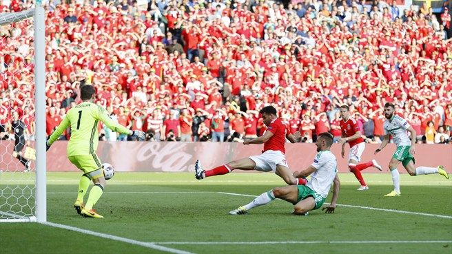Gareth McAuley (C) of Northern Ireland concedes a goal during their UEFA EURO 2016 Round of 16 match against Wales