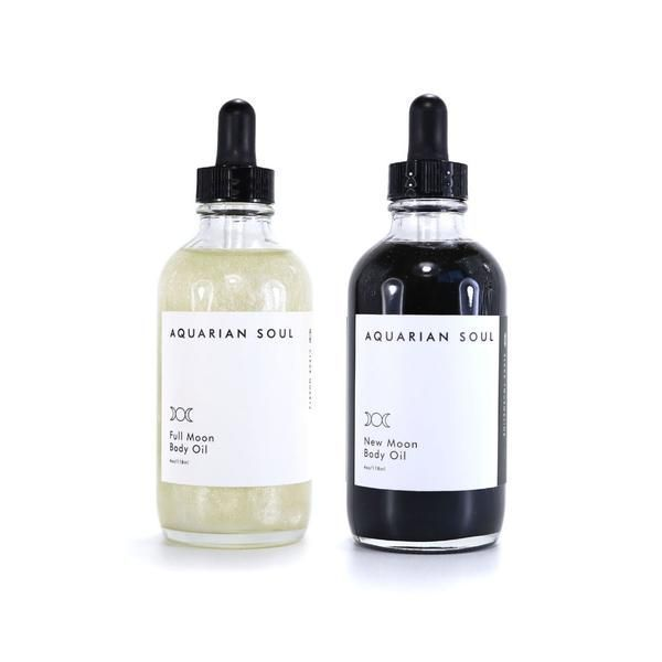 This set is based around the moon cycle. New Moon is a shimmering black oil, which only appears black in the bottle. It has small amounts of reflective mica to give it a black tint, which will not stain your skin black. Full Moon is a bright, luminescent white oil with a sheer shimmer. It adds just the right amount of shimmer to your skin. It shines just like a full moon does on a dark night. This oil is super moisturizing and luxurious. Apply after a bath or shower to retain the moisture…