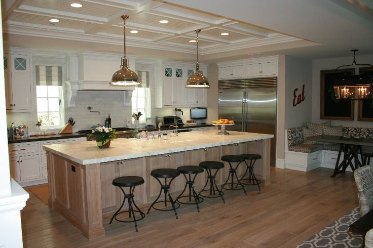 Large Island With Seating Also Additinal Storage Cabinets On The