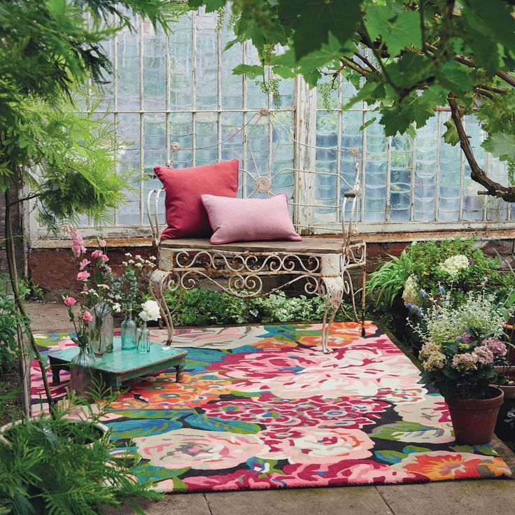 Rose & Peony Rugs 45005 by Sanderson features a modern floral design containing a rainbow of colour with a domineering cerise pink tone which will make a showpiece in any room.