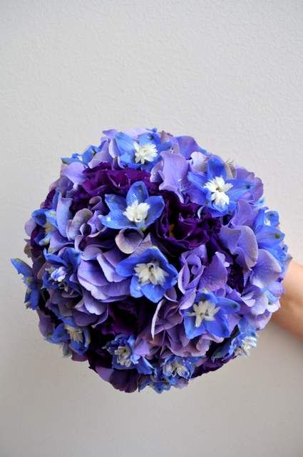 Purple lisanthus and blue delphinium - designed by Arioso