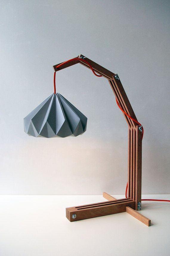 An unusual light mixture of origami, chestnut wood, and that great pop of red wire. I see it in a boy's room on his desk for homework or nightstand. This lamp is by Etsy designer nellianna